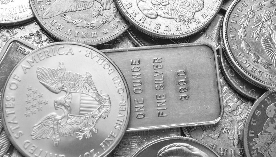 Silver coins and bars background