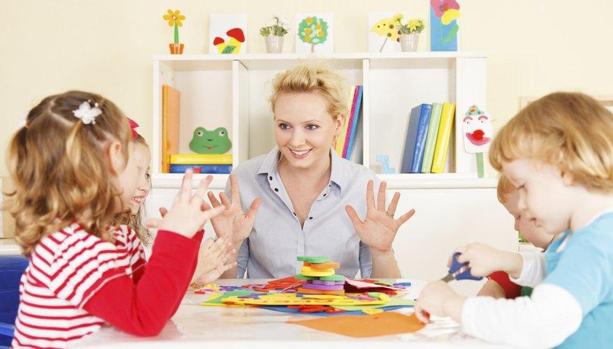 A preschool teacher giving a math lesson.