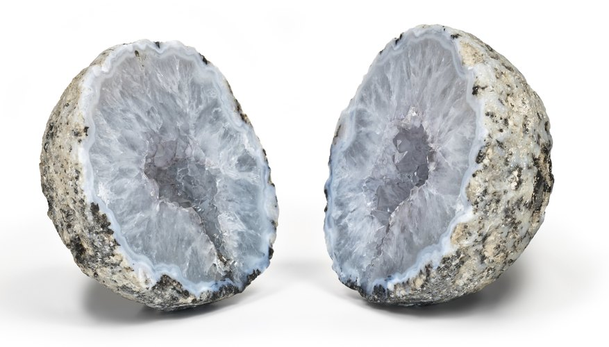 Correcty using the right settings on a iron pipe cutter will split the geode in two.