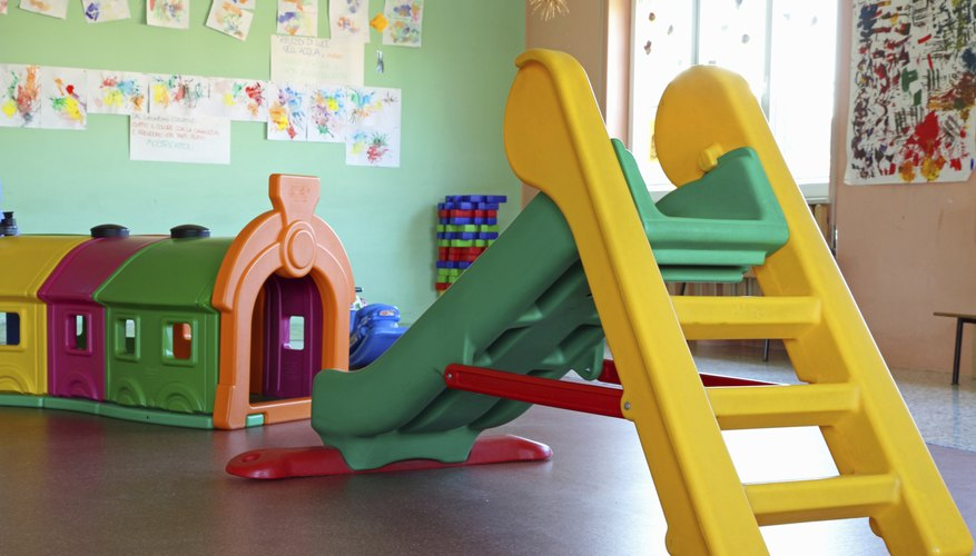 slide and plastic tunnel in the playroom of a preschool