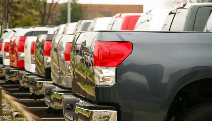 A fleet of parked pick up trucks.