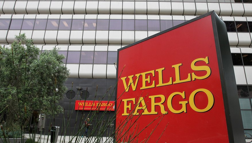 A Wells Fargo sign in front of a bank branch in California.