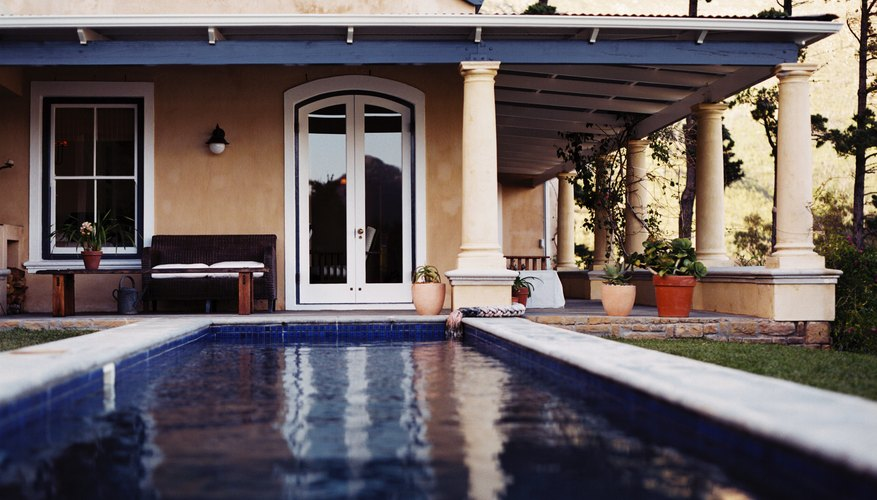 view of a swimming pool in the backyard of a house