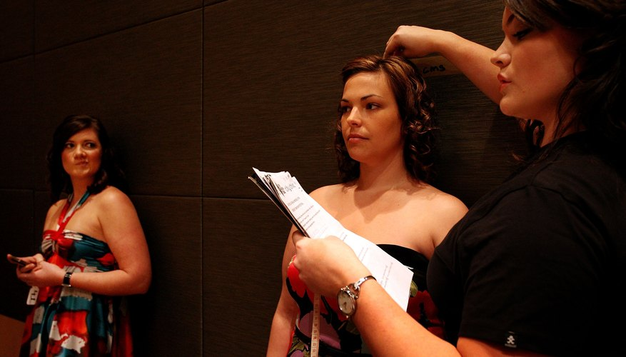 Two plus-size teen model contestants at a competition.