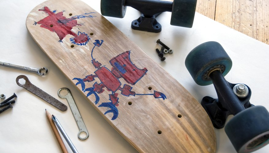 Skateboard disassembled with tools