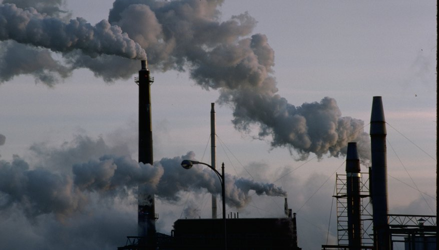 Factory smokestacks can emit carbon dioxide into the environment, a source of point source pollution.