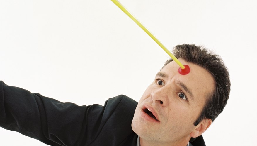 Man with toy arrow on forehead