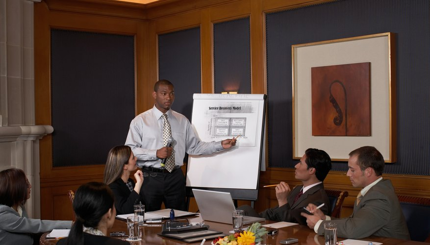 Man giving presentation to colleagues in conference room