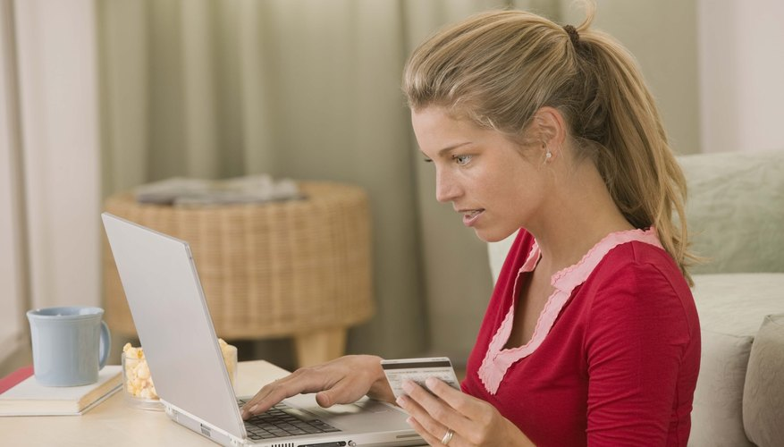 Woman with a credit card making an online purchase