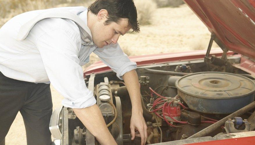 Man fixing vintage convertible