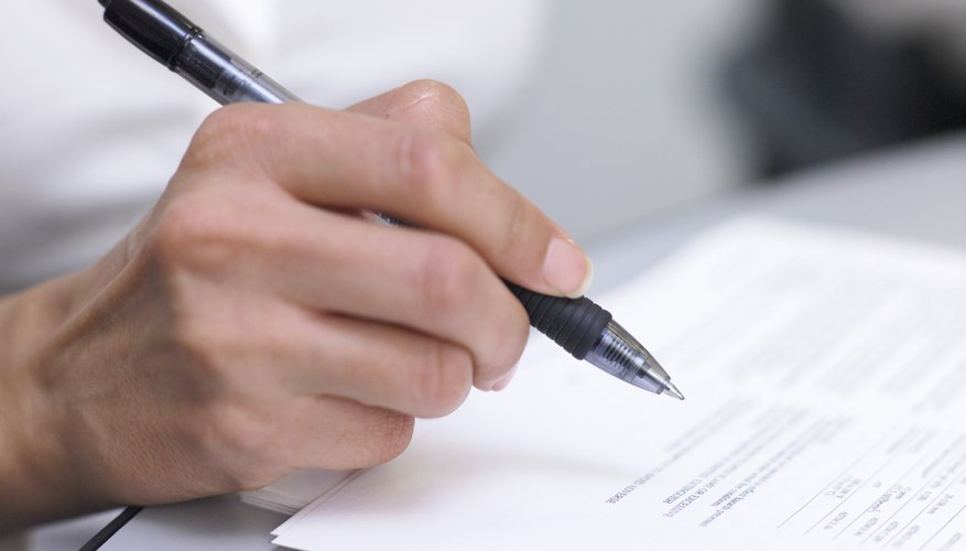 Businessperson holding pen