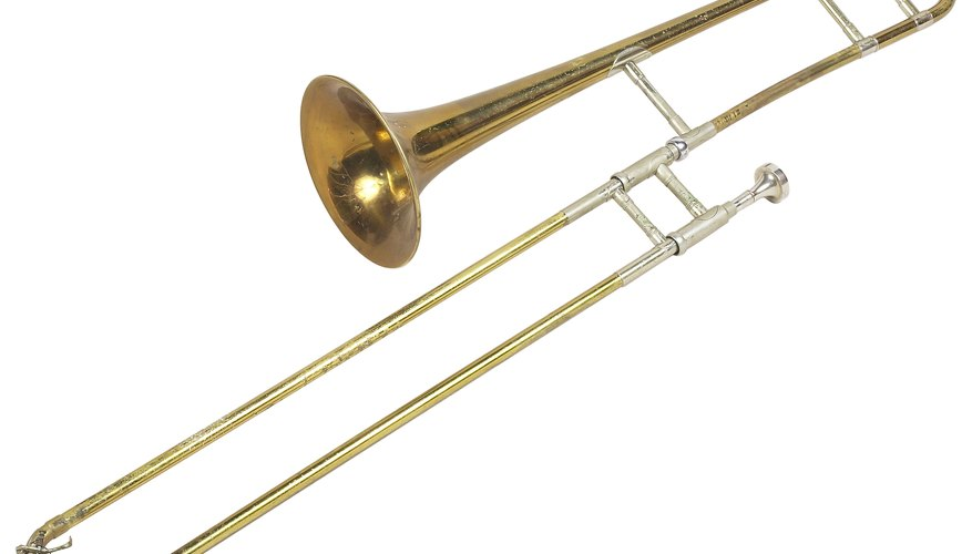 A cover slips over the mobile section of the trombone slide without covering the joint.