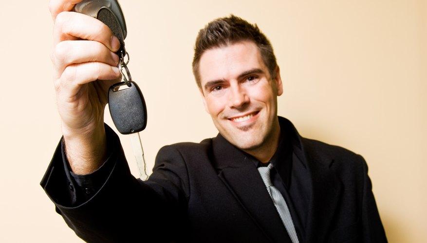 Car salesman holding keys