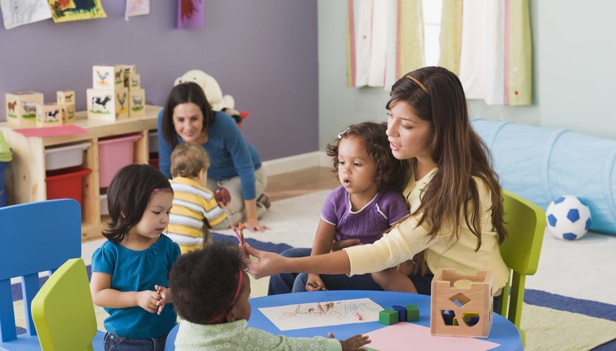 A supportive caregiver at daycare can support toddlers in learning to share and take turns.