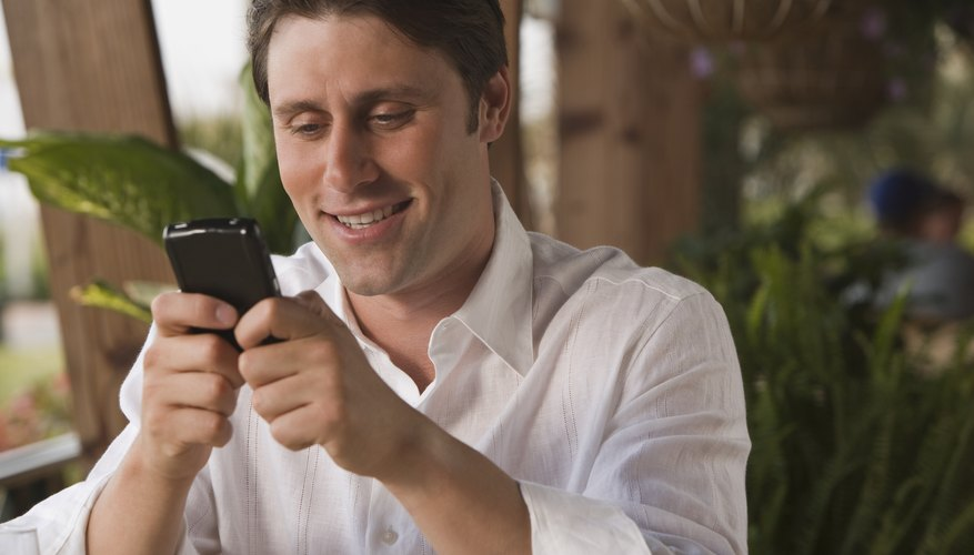 Young adult male using his smart phone
