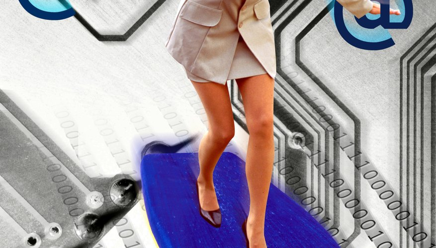 Businesswoman surfing on circuit board (Digital Composite)