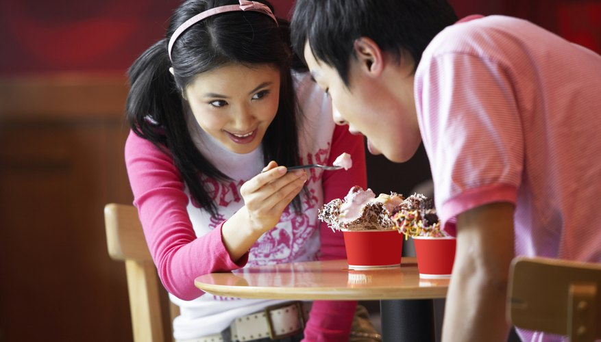 Young kids are eating ice cream.