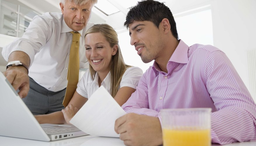 Couple and financial adviser with laptop