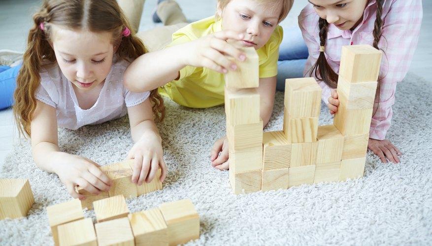 Children play with wooden blocks