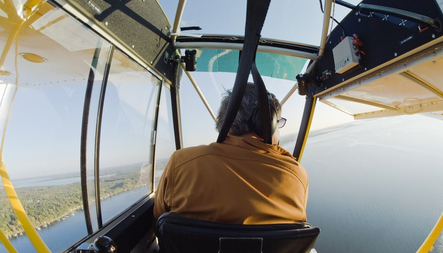 A man flies a home built floatplane.
