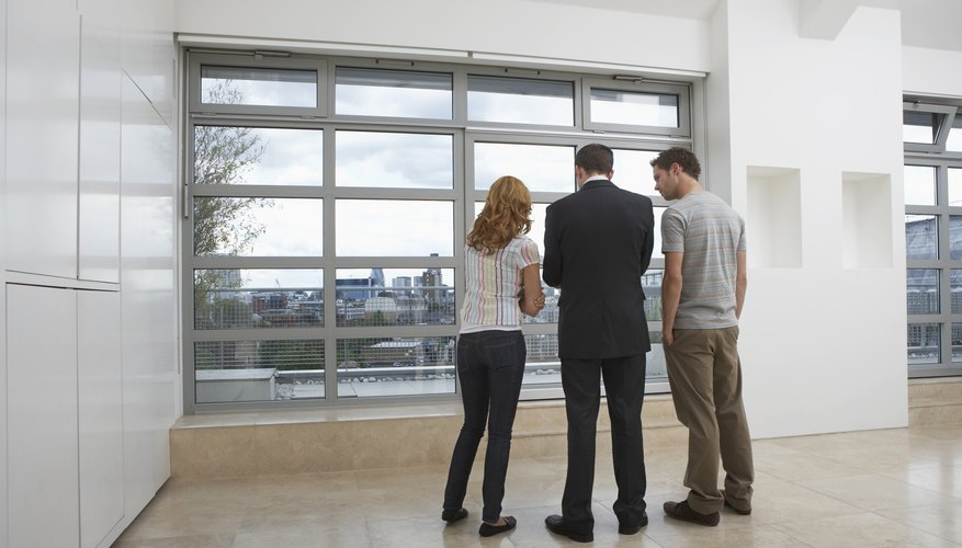 Couple with an agent looking at an apartment.