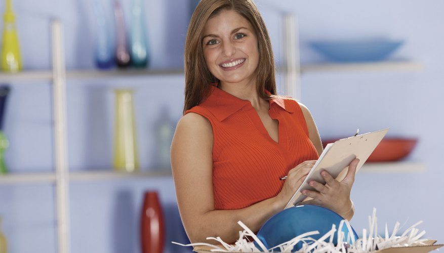 Woman with shipment of ceramics in retail store