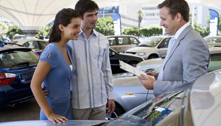 Salesman showing couple a car