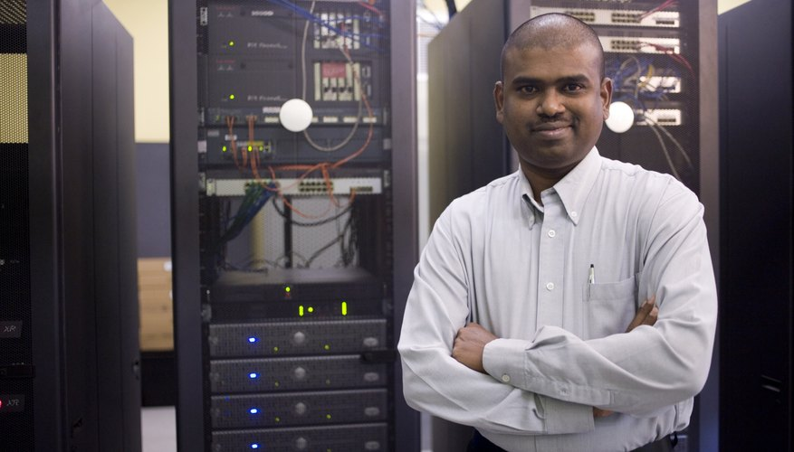 Portrait of a technician standing in front of network servers