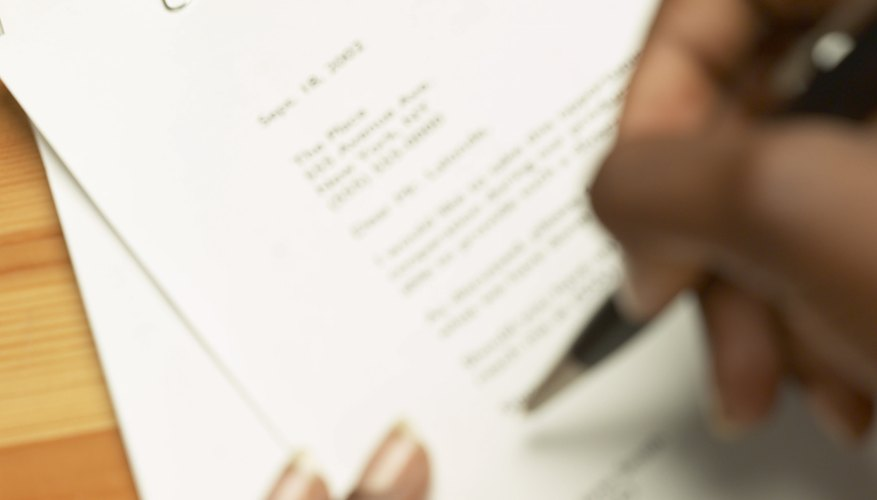 Close-up of hands signing a car insurance documents