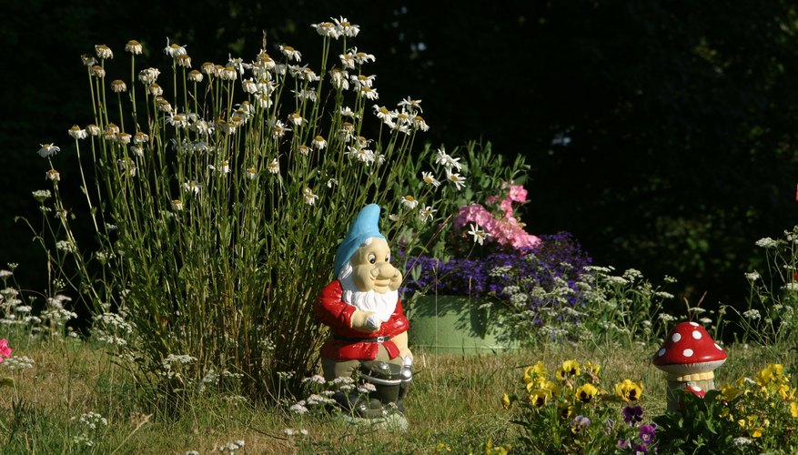 Attach a decorative gnome door to a large rock or garden structure.