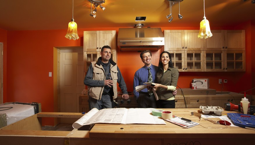 Couple with architect in new home