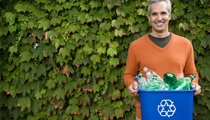 Man with recycling bin and ivy