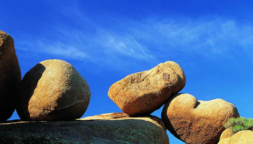 Granite boulders like these are shaped by spheroidal weathering.