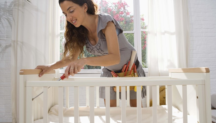 When the baby becomes more mobile, lowering the crib mattress is an important safety precaution.