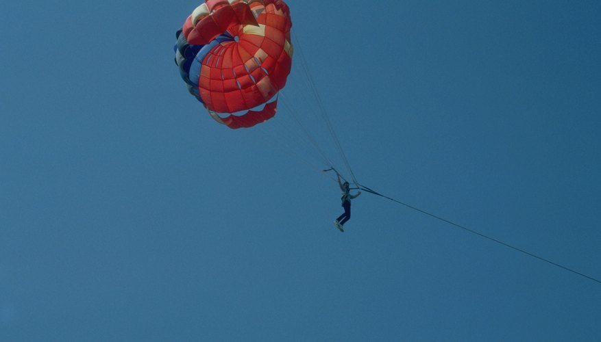 Air resistance works against gravity to help parachuters descend safely to the ground.