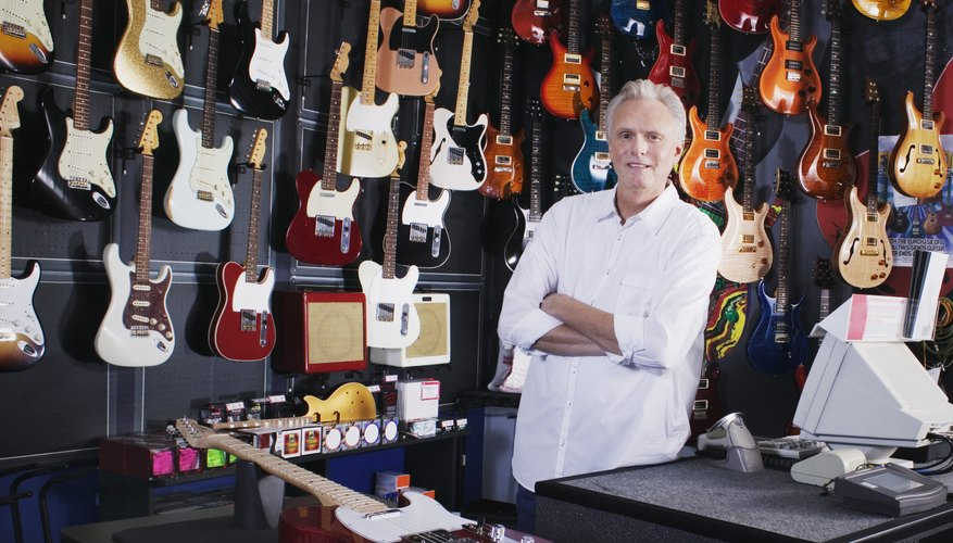 Man behind counter in guitar shop