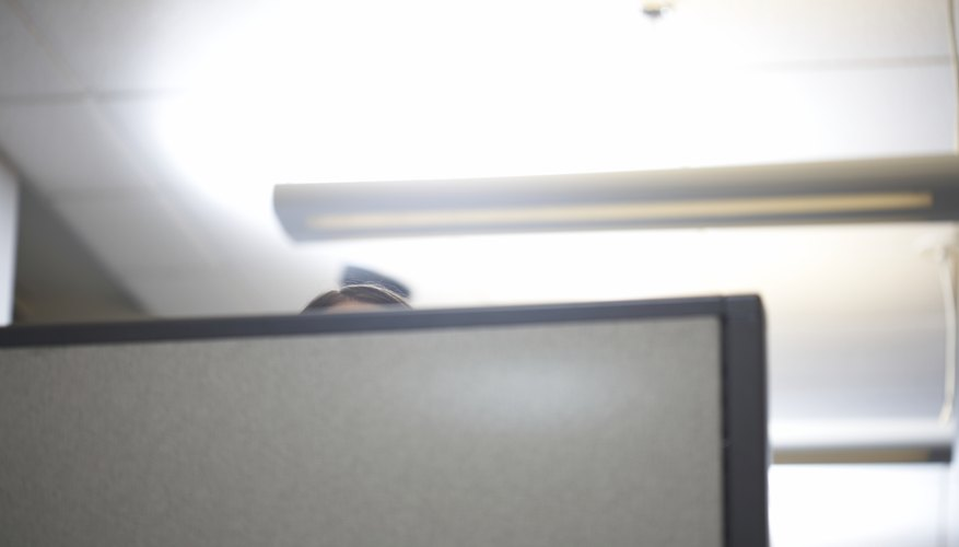 Top  of woman's head over office cubicle