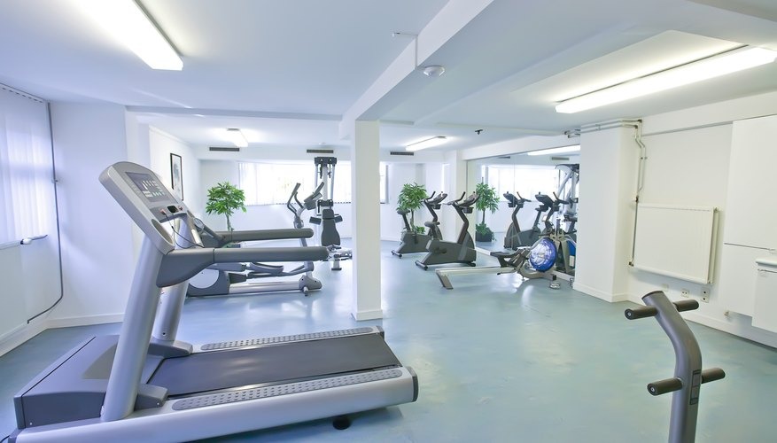 A small gym with treadmills and cardio machines.