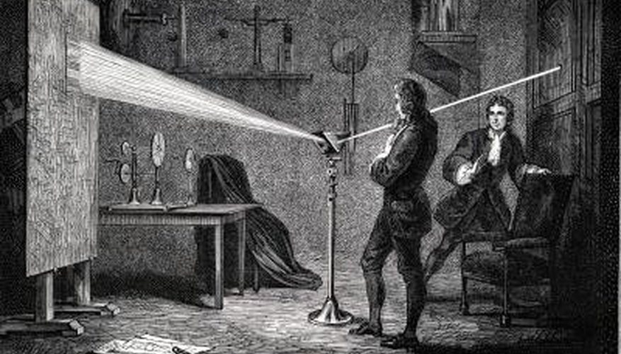 Isaac Newton conducting an experiment with a prism