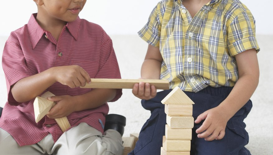 Demonstrate and encourage sharing to reduce your child's impulse to take toys from others.