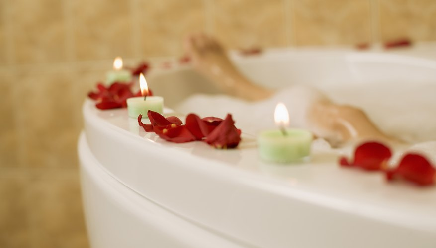Use rose petals to create a romantic atmosphere in your hotel room.