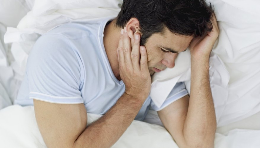 Man waking up due to pain