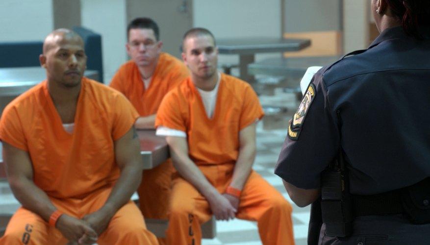 Prison guard talking to inmates