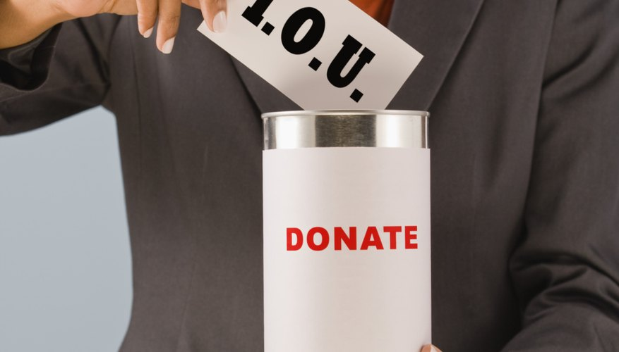 Woman putting IOU in donation can