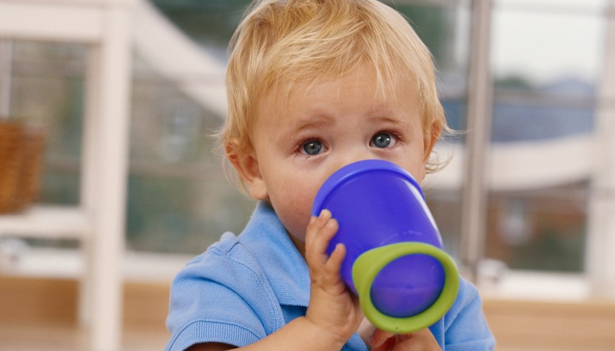 Baby boy drinking from sippy cup