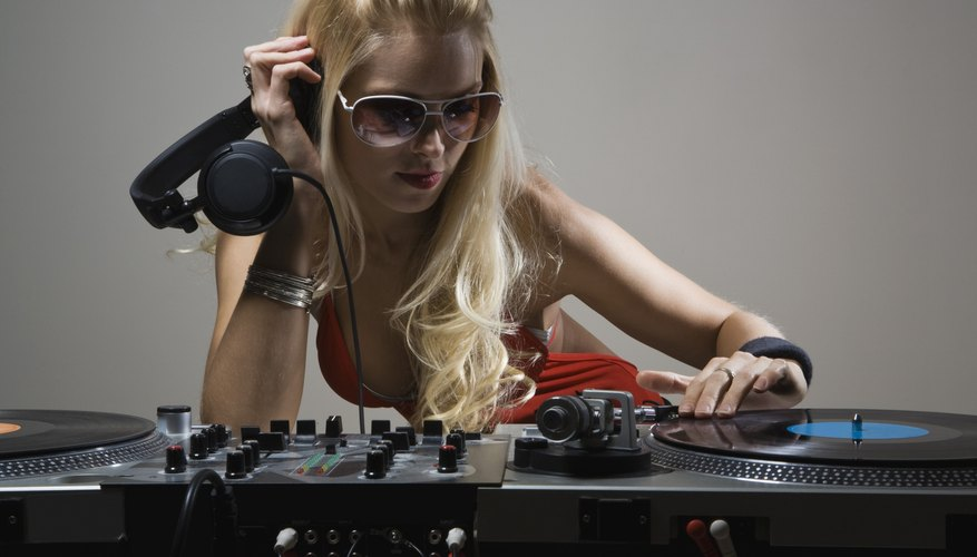 Disc jockey with turntables and headphones