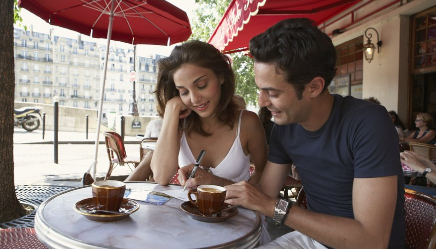 Couple getting coffee at cafe