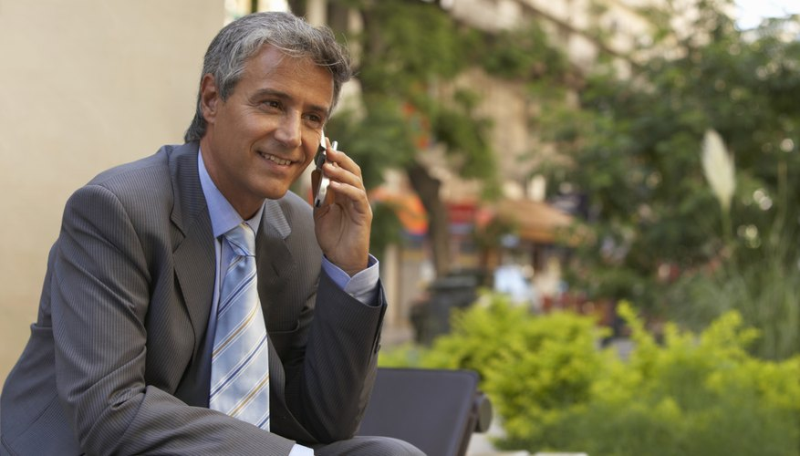 Smiling businessman on a cellphone.