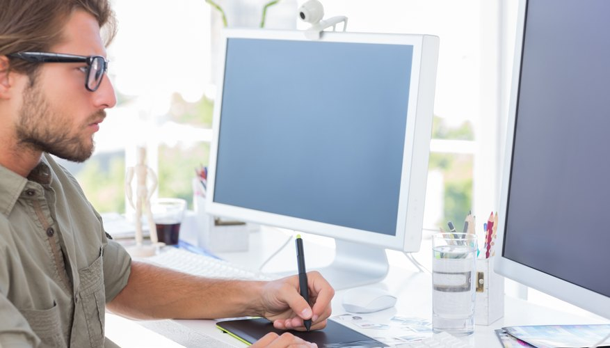 Graphic designer using graphics tablet