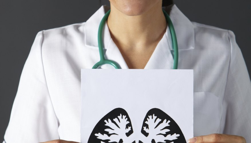Nurse holds picture of lungs
